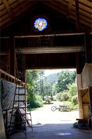 BARN SUNTRACKER WINDOW : This view out the front door of the barn shows the beautiful setting of the barns.