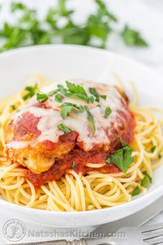 This Chicken Parmesan Recipe is so juicy and easy to make. A family favorite! @natashaskitchen