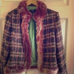 Faux fur vintage blazer Mauve fur lines the trim, collar and sleeves of this bold blazer. Fastens closed if desired. Lined on inside and in great condition. Mint green lining inside. Vintage store Jackets & Coats Blazers