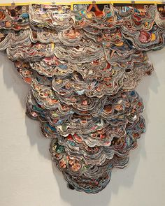 Sculpture made from recycled National Geographic magazines   by Hong Seon Jang