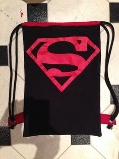 SuperMan backpack. I made this for my Super Hero. He uses it to pack his gym stuff and work out towel and wears it to the public gym. I know he keeps it packed. He owns another backpack. It's one of two of the A's - Kiss Backpacks. (I made 2)