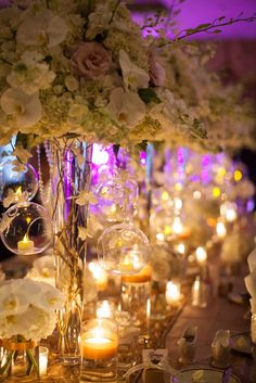 Lights, flowers, action! You can never go wrong with lavish flowers and abounding candles for a head table. Photo by talented @auramarzouk, flowers by @eliananunesfloraldesign See more here: https://www.eliananunes.com/florist-blog/
