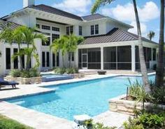 Stunning British West Indies custom built home in prestigious Old Marsh Golf Club, nestled on peaceful cul-de-sac locale with eastern exposure, private golf and lake views of the Pete Dye Championship course. For more information about this property click here: http://idx.waterpointerealty.com/idx/details/homes/c006/RX-3145333/13360-Marsh-Landings-Palm-Beach-Gardens-FL-33418