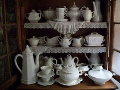 China cabinet with white dishes
