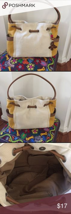 NWOT Relic shoulder bag cotton-canvas Spring Ready New (w out tags) Relic Shoulder bag.. cotton canvas material, mostly Khaki cream color, but sides are mustard color, brown leather handles woven thru metal grommets give a nice detail touch, lrg magnet snap close, 2 deep outside side-pockets and 2 inside pockets- 1 zips..super cute wooden butterfly accent dangle can be removed.. Relic Bags Shoulder Bags