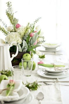 Spring tablescape from Magnolia | White plates, green apples and lots of tulips!