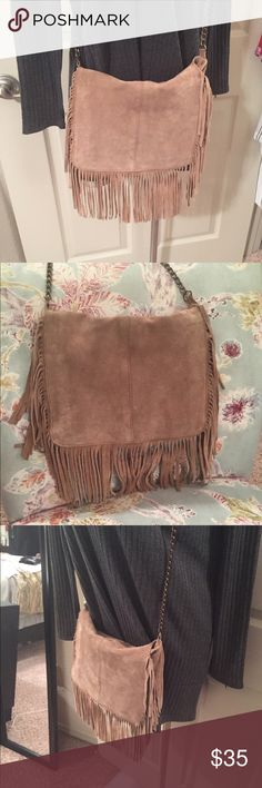 Suede fringe crossbody Genuine suede tan fringe cross body. 12 inches width approx 9 inches height. Slight wear, in great condition. Small black ink pen stain on the interior bottom Francesca's Collections Bags Crossbody Bags