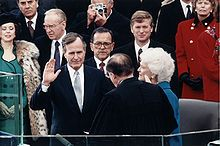George H. W. Bush - taking the oath of office as the 41st  President of the US 01/20/1989. He became involved in politics soon after he founded his own oil company, & served as a member of the House of Representatives and Director of Central Intelligence. Domestically he reneged on a 1988 campaign promise, struggled with Congress, and signed a tax increase that Congress had passed.