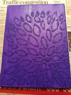 Paint over hot glue gun designs on canvas for a cool effect.