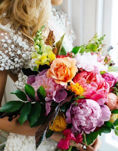 These Are Summer 17's Trendiest Wedding Bouquets - Wilkie Blog! - Multi colored blooms with green accents
