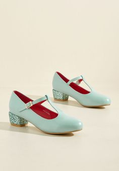 There's something in the way these faux-leather heels move that makes your heart skip a beat! It could be their sky blue hue, or maybe the way their aqua glitter heels catch the light - whatever it is, this pretty pair has your heart!