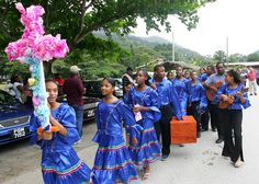 In Trinidad, traditional Parang music is performed around Christmas time, when singers and musicians (collectively known as the parranderos) travel from house to house in the community, often joined by friends and neighbors.