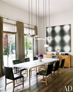 Contemporary dining room with modern art #dining #style #design