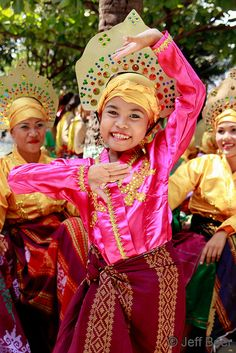 "A young girl dances in the annual Aliwan Fiesta in Manila.  The event, known as ""The Mother of All Fiestas,"" showcases Filipino cultures and heritage."