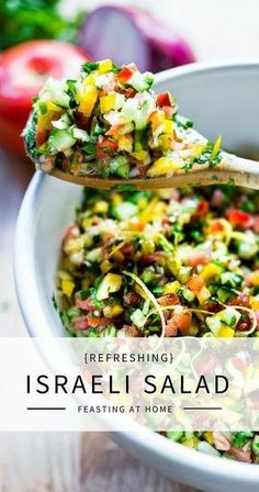 Simple healthy Israeli Salad made with finely chopped vegetables, fresh herbs, lemon and olive oil. Vegan and Gluten Free! | www.feastingathome.com #israelisalad #vegan #vegansalad #veggies #lunch #middleeastern #healthysalad