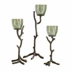 """Showcasing tree branch silhouettes and green glass sconces, this nature-inspired set of candleholders adds a rustic touch to your mantel or entryway console.   Product: Small, medium and large candleholder setConstruction Material: Aluminum and glassColor: Bronze and greenAccommodates: 3 Candles - includedDimensions: Small: 16"""" H x 6"""" W Medium: 17"""" H x 7"""" W Large: 22"""" H x 8"""" W"""