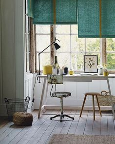 An otherwise unused alcove in a bay window, with its view out to the garden, is a delightful location for a study area. Opting for a pared-back desk and simple seating means that the work space won't intrude on the rest of the room. The neat blinds screen out bright sunlight, while a clamped lamp is a versatile choice. #study #office #interior #countrystyle styling by Emma Thomas, Ali Brown and Laura Vinden, photograph by Emma Lee.