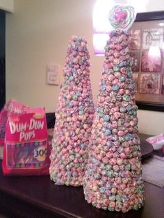 Made these Dum-Dum candy trees for our Re-Grand Opening part at Old Navy. 600 Dum-Dums on each styrofoam cone.