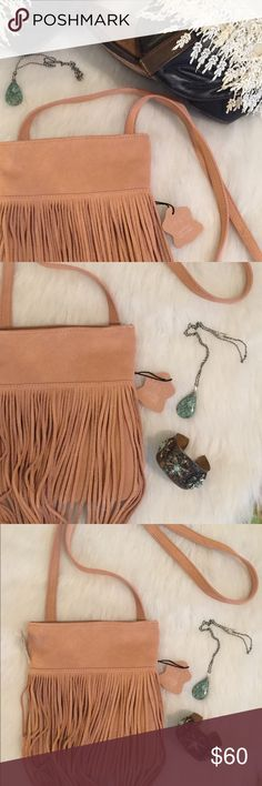 "NWOT MARGOT Rose suede crossbody boho fringe bag NWOT MARGOT rose genuine suede leather crossbody fringe boho bag, interior tan polyester lining with zip and large slip pockets. H 9"" x L 8"" x D 1"" Strap drop 23"". There is one piece of broken fringe, as you can see in the image. This is a tight little boho bag, super cute. Buy it before I take it down! Margot Bags"