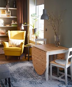 Compact Kitchen With Armchair Table And Chair