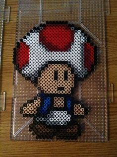 Toad Perler beads by Khoriana on DeviantArt - pegs needed. Toad Perler beads by Khoriana on deviantART - Melty Bead Patterns, Pearler Bead Patterns, Perler Patterns, Beading Patterns, Quilt Patterns, Hama Beads Mario, Diy Perler Beads, Mario Und Luigi, Mario Bros