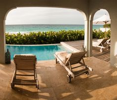 Meads Bay Beach Villas Outdoor Lounge Chairs and Pool, ranked #1 on Trip Advisor