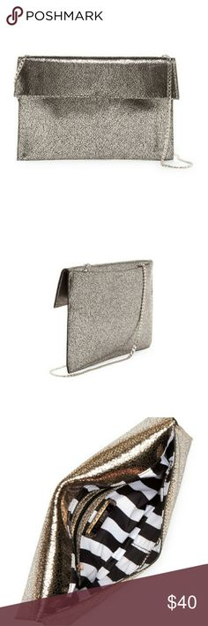 """Urban Expressions Vegan Leather Clutch Detachable chain strap with 24"""" drop, gunmetal. Foldover top with magnetic closure. Exterior has back slip pocket with magnetic closure. Interior has 1 wall zip pocket and 2 wall slip pockets. Vegan leather exterior and fabric lining. 9"""" H x 13"""" W x 0.5"""" D. NWT. Includes dust bag. Urban Expressions Bags Clutches & Wristlets"""