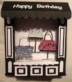 Made by Tina Morgan -Tattered Lace retail therapy die used to make the shop, boutique die - handbag set - paper pieced in Miri and glitter card to make the shop contents. Happy Birthday dies from the stage set