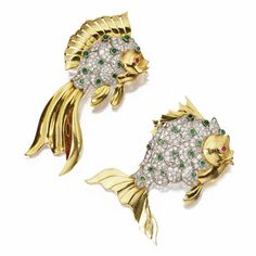 TWO GOLD, PLATINUM, DIAMOND, EMERALD AND RUBY FISH BROOCHES, CIRCA 1950