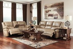 Style : Contemporary Color : Browns Type : Leather Collection : Lenoris Caramel Set Includes : Reclining Sofa & Reclining Loveseat with Console