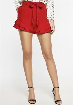 Bright and bold red is all we're lusting after.The Lexi Ruffle Short features a structured waistband with belt loops and tie belt, side pockets, mock back pockets, layered frills along the cuff and fly front with hook and bar.Couple with a relaxed cami to complete the look.Fabric Content: 96% Polyester, 4% ElastaneLining: 95% Polyester, 5% Elastane