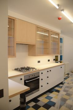 Kitchen   Beech Wall Units With Glass Sliding Doors. White Laminated Work  Top With Beech