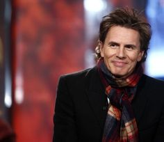 John Taylor. And a scarf and a nice black coat. I'm in love!