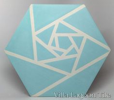 Origami Blue cement tile, in a 9x6 layout. $16.86 per sq ft or so.