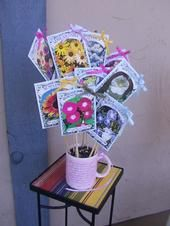 Seed Packet Bouquet Gift    TAKE SEED PACKETS, GLUE TO BAMBOO SKEWER. PLACE IN VASE FILLED WITH BIRDSEED. MAKES A GREAT GIFT FOR THE GARDENER.