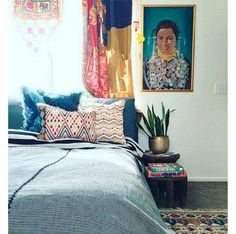 """Colorful Bohemian: @justinablakeney -- Tap into your inner-boho spirit with a mélange of vintage textiles (some used as mismatched curtains!) and patterns in the bedroom. A beloved vintage oil painting, like the one Justina moved in from another room in the house, also makes for great company. Shop the pieces you need to get the look and see more bedroom interior design inspiration in """"9 Inspiring Instagram Bedroom Ideas to Steal"""" on the One Kings Lane Style Guide!"""