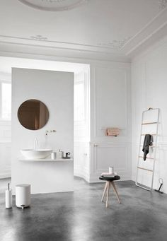 beautiful clean bathroom. love the traditional molding and modern pieces - the divider and the off-center mirror. (Norm Architects—Menu)