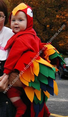 Baby parrot costume using a red jumpsuit and lots of felt. Cute!