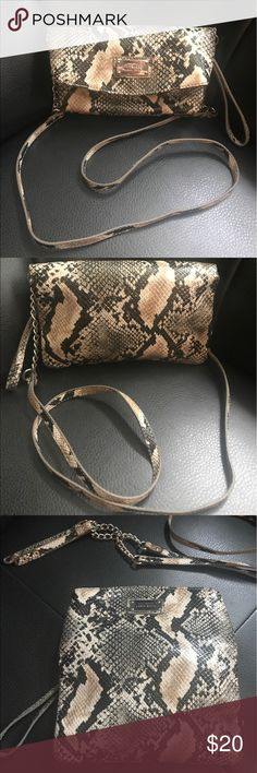 Nine West Snakeskin Crossbody Wristlet Authentic Gorgeous Nine West Crossbody (faux) Snakeskin Handbag with removable strap. Also can be used as a Wristlet or Clutch when strap is taken off! Silver Nine West nameplate on exterior while interior features three large pockets and snap closure. Like new. Nine West Bags Crossbody Bags