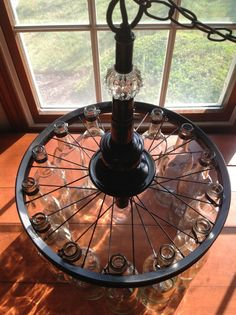 Wine Bottle Chandelier Black with Cystal by ChandelierEngineer, $269.00. Love using old bicycle rims.