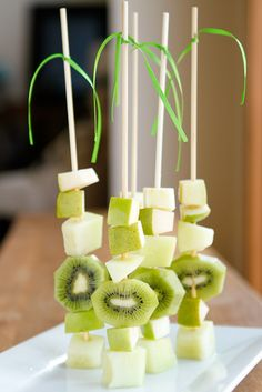 Fruit Skewers -- these green ombre fruit kabobs are a surefire way to get kids to eat their fruit, especially when paired with my fave cream cheese fruit dip... A simple, easy and healthy St. Patrick's Day treat!