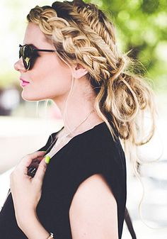 Combining a regular braid with a fishtail braid is an unexpected twist to this messy-chic look. // #Hair