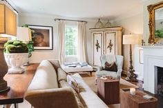 The subtle palette of colors in the living room offers a sophisticated look that highlights Gavin and Lorie's gorgeous antiques. Silk Firesi...
