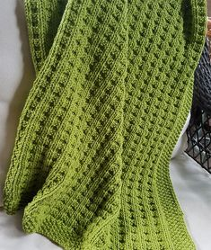 """Free Knitting Pattern for Easy 4 Row Repeat Cuddly Baby Blanket - This 4 row repeat creates a squishy texture that looks great on either side. It looks like waffle stitch to me. Quick knit in bulky weight yarn. Finished Size: Approx 31 x 34"""". Rated easy by Ravelrers. Designed by Sarah Keller. Pictured project by pdizzell"""