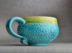 Love the turquoise color of this tea cup