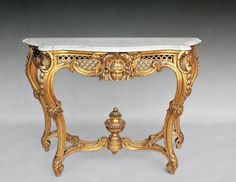 Large #console carved and #gilded in the #LouisXV #style. It rests on four fluted legs and highlighted with acanthus leaves. Top in white marble veined with a molded edge. Late #19th century. For sale on #Proantic by Galerie Tramway.