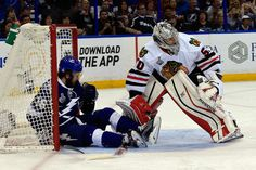 TAMPA, FL - JUNE 13: Nikita Kucherov #86 of the Tampa Bay Lightning falls into the net past Corey Crawford #50 of the Chicago Blackhawks in the first period of Game Five of the 2015 NHL Stanley Cup Final at Amalie Arena on June 13, 2015 in Tampa, Florida. (Photo by Scott Iskowitz/Getty Images)