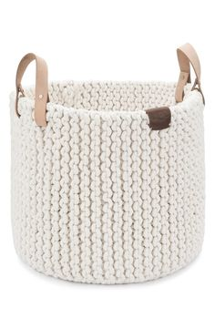 Ideal for storage or display, this hand-woven rope basket provides an attractive addition to the décor.