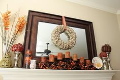 I ruffled burlap wreath, and pumpkins on silver candlesticks