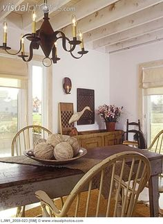 FARMHOUSE – INTERIOR – early american decor inside this vintage farmhouse seems perfect, like this beautiful rustic country dining area.